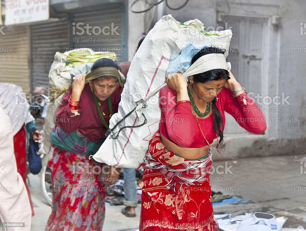 Nepalese women carry things in the traditional way,Nepal. royalty-free stock photo