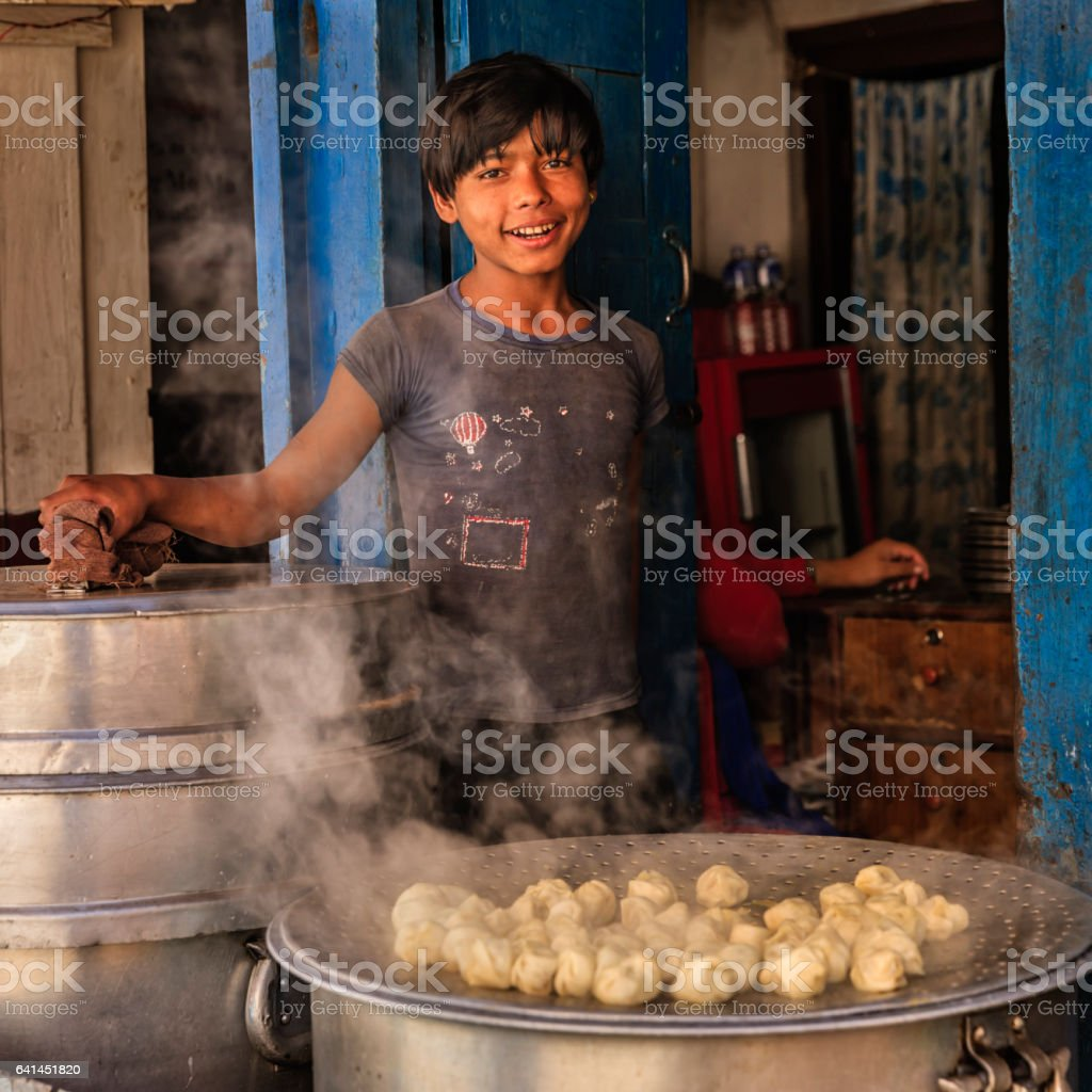 Nepalese young street vendor selling momos (dumplings), Bhaktapur stock photo