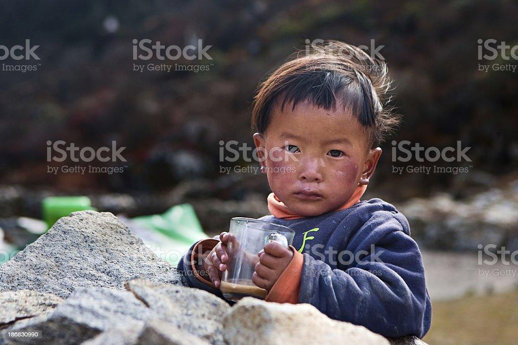 Nepali boy drinking milk tea. stock photo