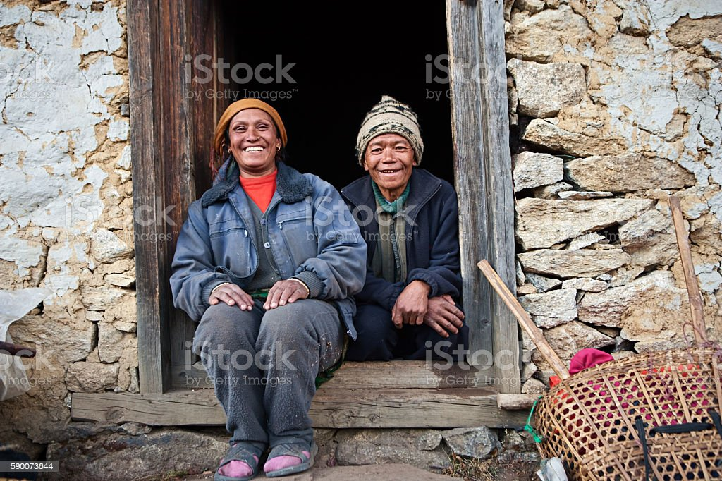 Nepali couple in front of their house stock photo