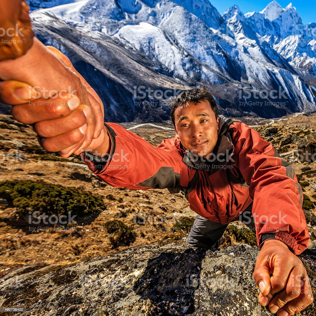 Nepali 'Everest Sherpa' climbing in Himalayas stock photo