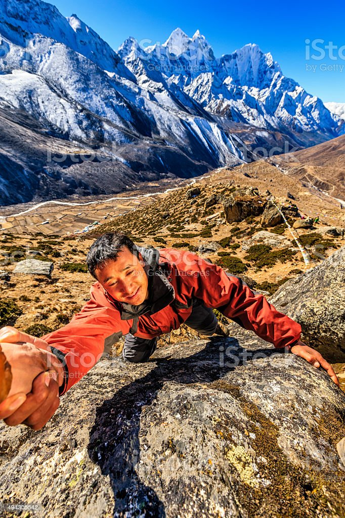 Nepali 'Everest Sherpa' climbing in Himalayas stock photo
