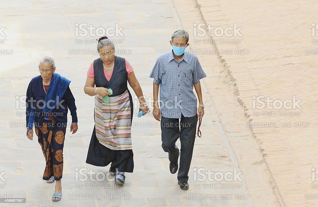 Nepali faithfuls around the Boudhanath-Bodhnath stupa. Kathmandu-Nepal. 0327 royalty-free stock photo