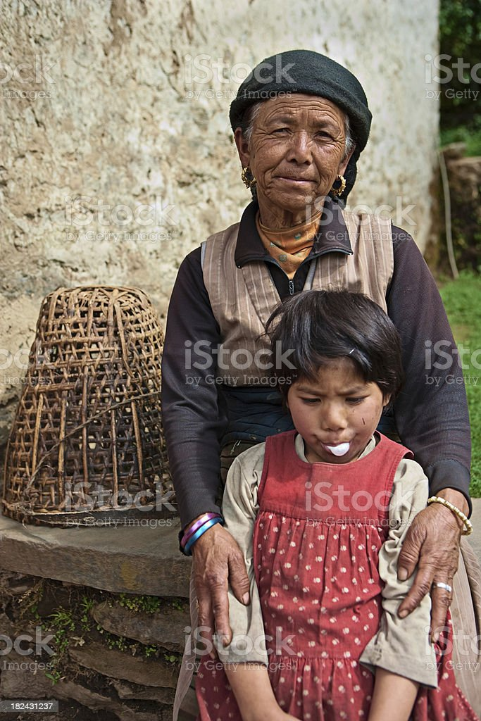 Nepali grandmother with her granddaughter  in Sagarmatha National Park royalty-free stock photo