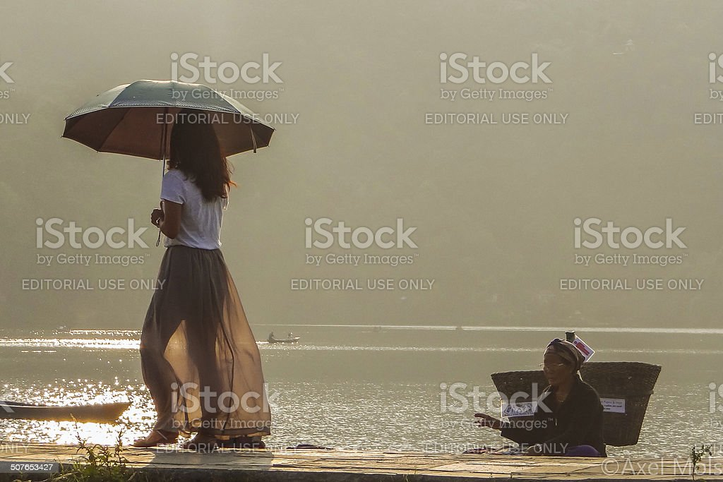 Nepali lady at Fewa Lake stock photo