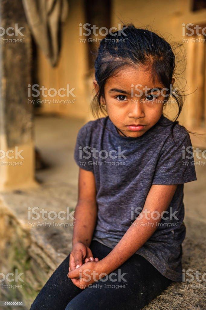 Nepali little girl  in village near Annapurna Range stock photo