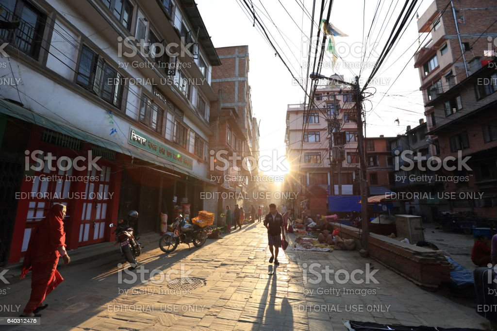 Nepali people walking onl street under sunrise in the morning stock photo