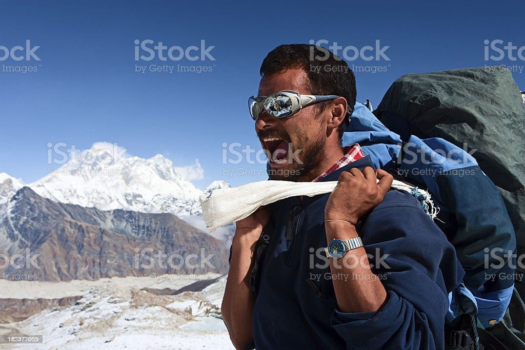 Nepali porter against a background of Mount Everest royalty-free stock photo