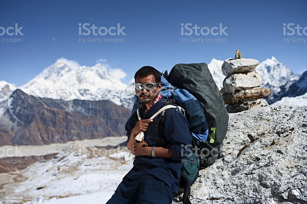 Nepali porter against a background of Mount Everest stock photo