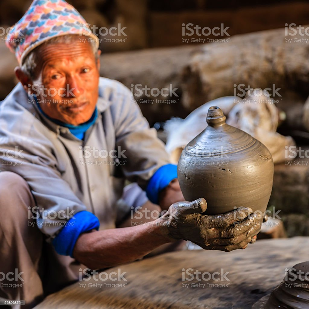 Nepali potter working on the pottery square in Bhaktapur stock photo
