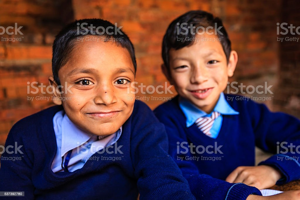Nepali schoolboys during the class stock photo