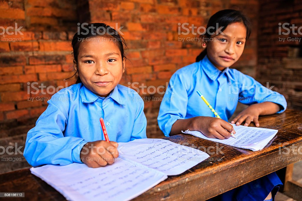 Nepali schoolgirls in classroom stock photo