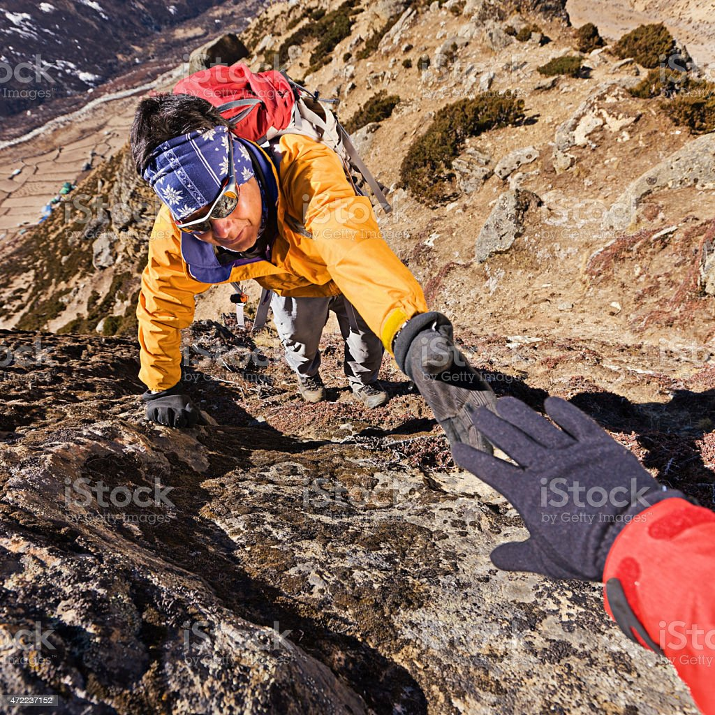 Nepali sherpa climbing in Himalayas stock photo