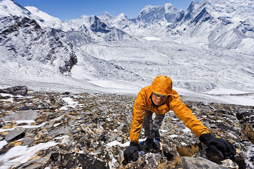 Nepali sherpa climbing in Himalayas stock photo