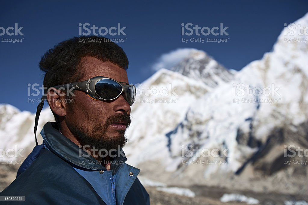 Nepali Sherpa is looking over Himalayas stock photo