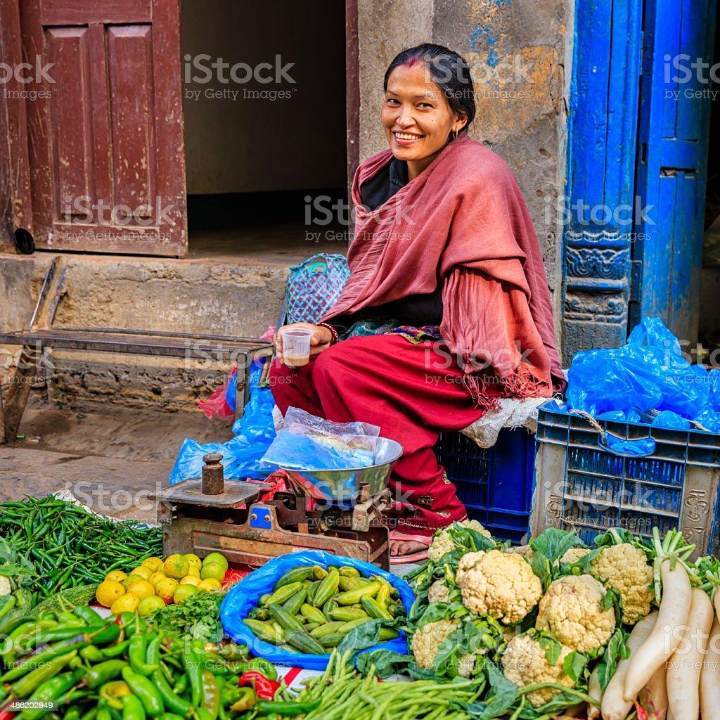 Nepali street seller in Kathmandu, near Durbar Square, Nepal stock photo