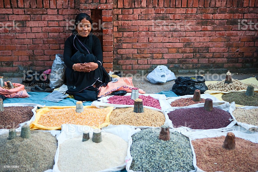 Nepali street seller - selling beans and spices in Kathmandu stock photo