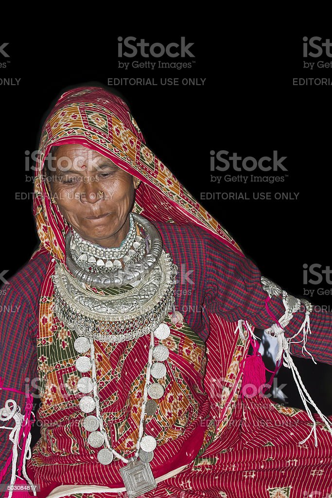 Nepali taru woman wearing tradional clothes and jewelery stock photo