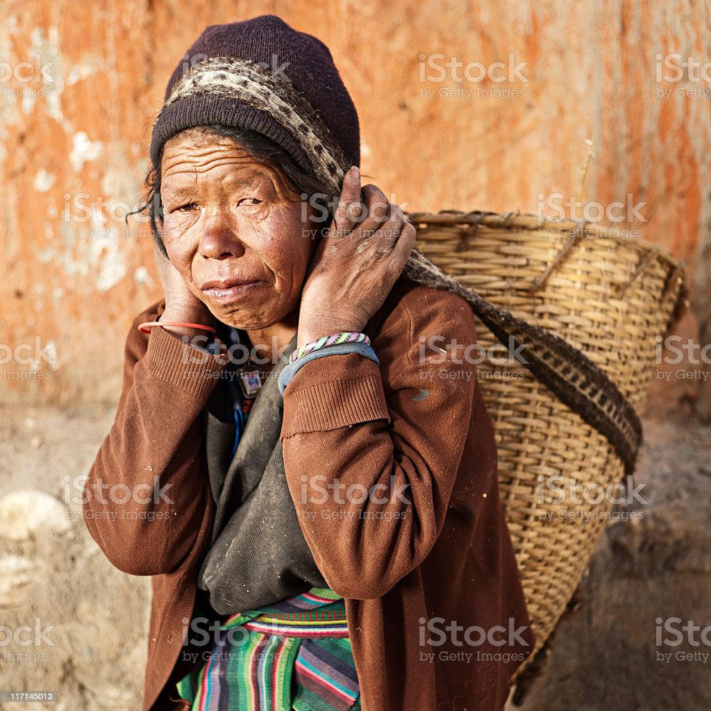 Nepali woman carrying basket royalty-free stock photo