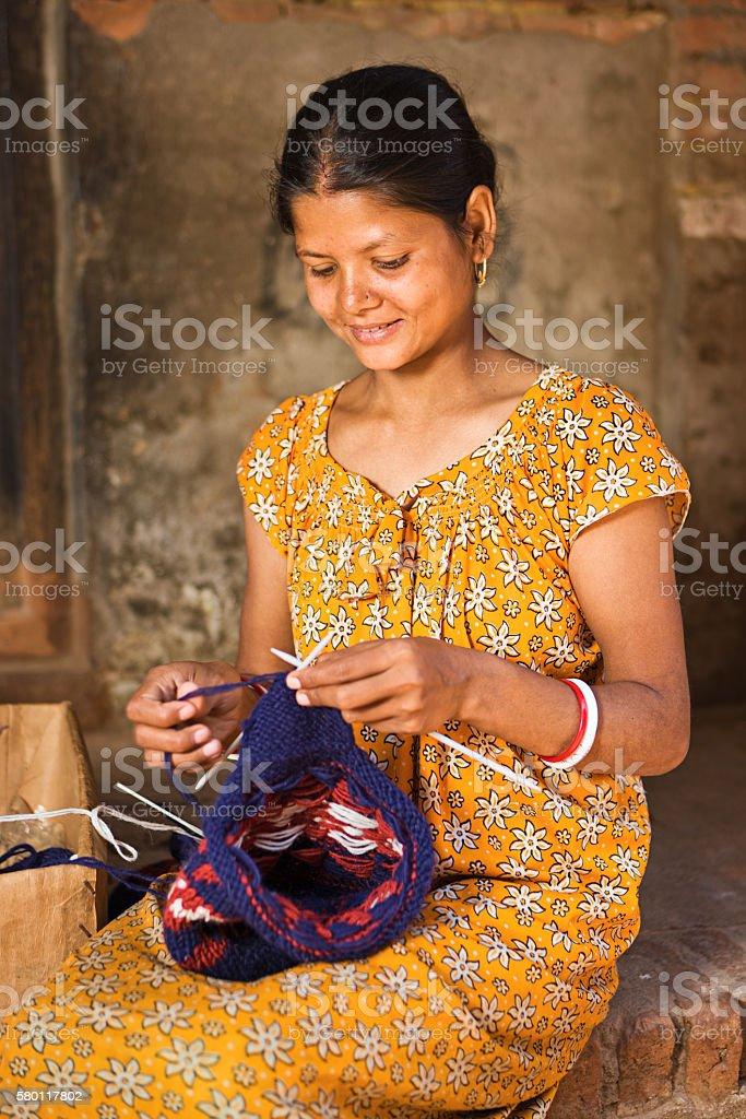 Nepali woman kniting wool hat. Bhaktapur. stock photo