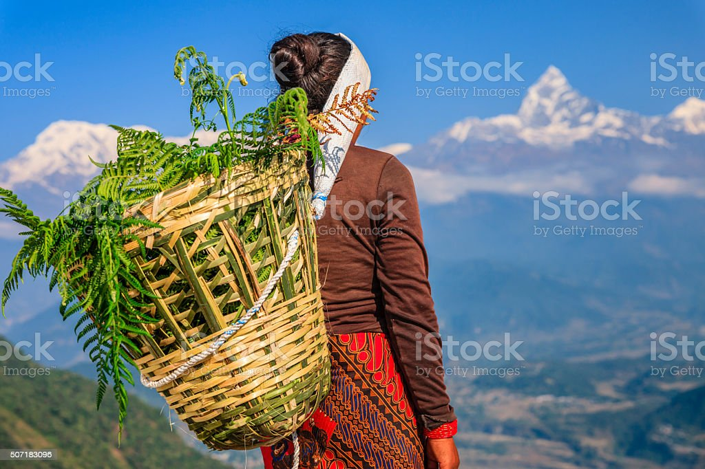 Nepali woman looking at Machapuchare, Pokhara, Nepal stock photo