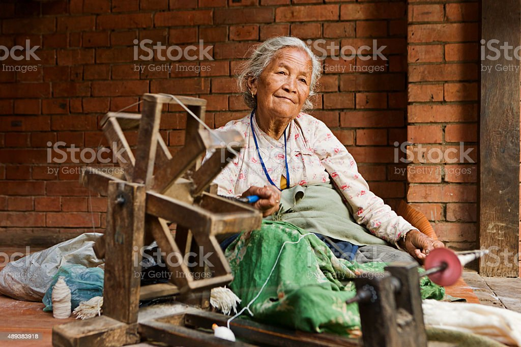 Nepali woman spinning the wool. Bhaktapur stock photo