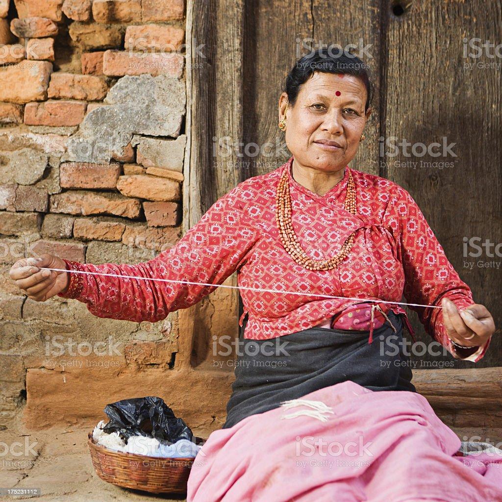 Nepali woman spinning the wool royalty-free stock photo