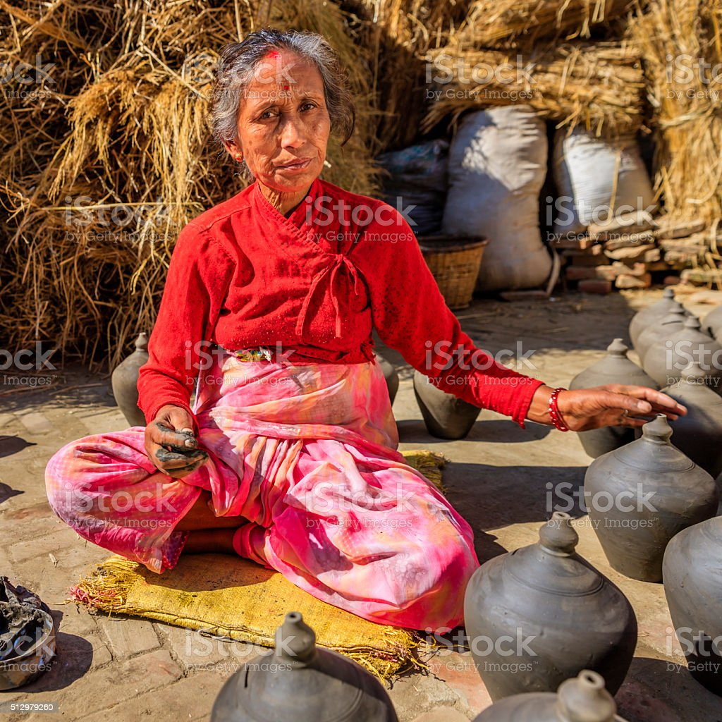 Nepali woman working on the pottery square in Bhaktapur stock photo