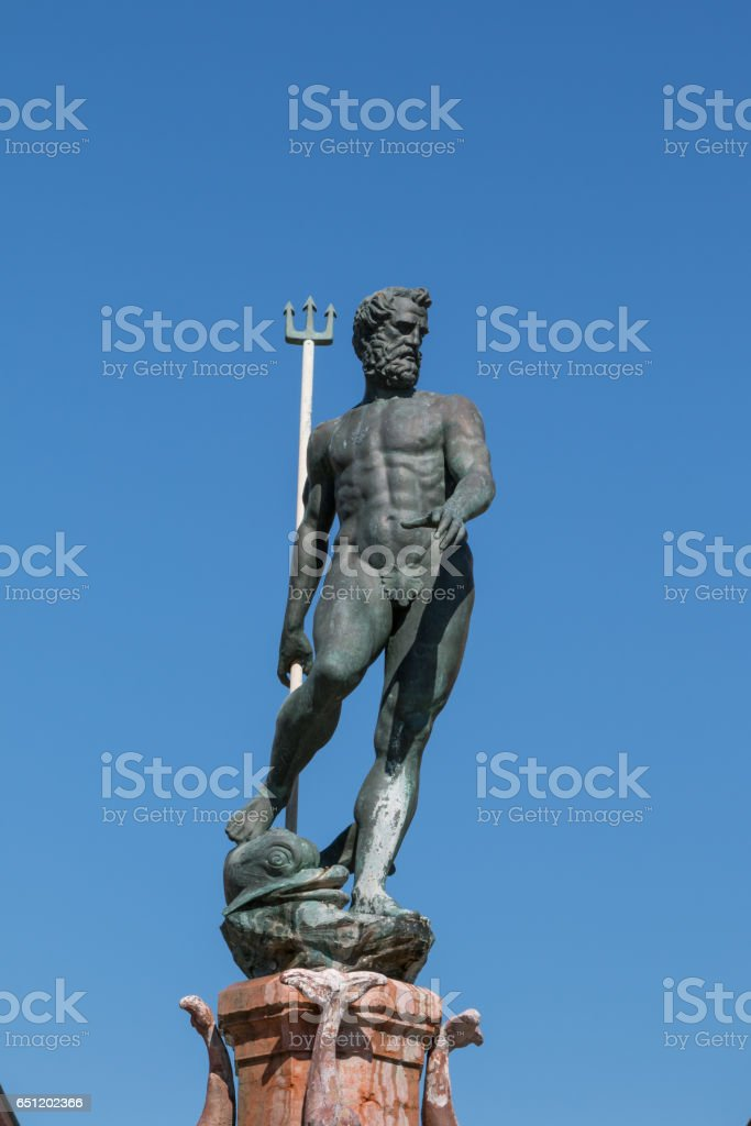 Neptune Bronze Statue with Trident Scepter and Blue Sky in background stock photo
