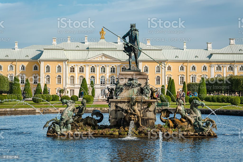 Neptune fountain and Grand Petergof Palace on background stock photo