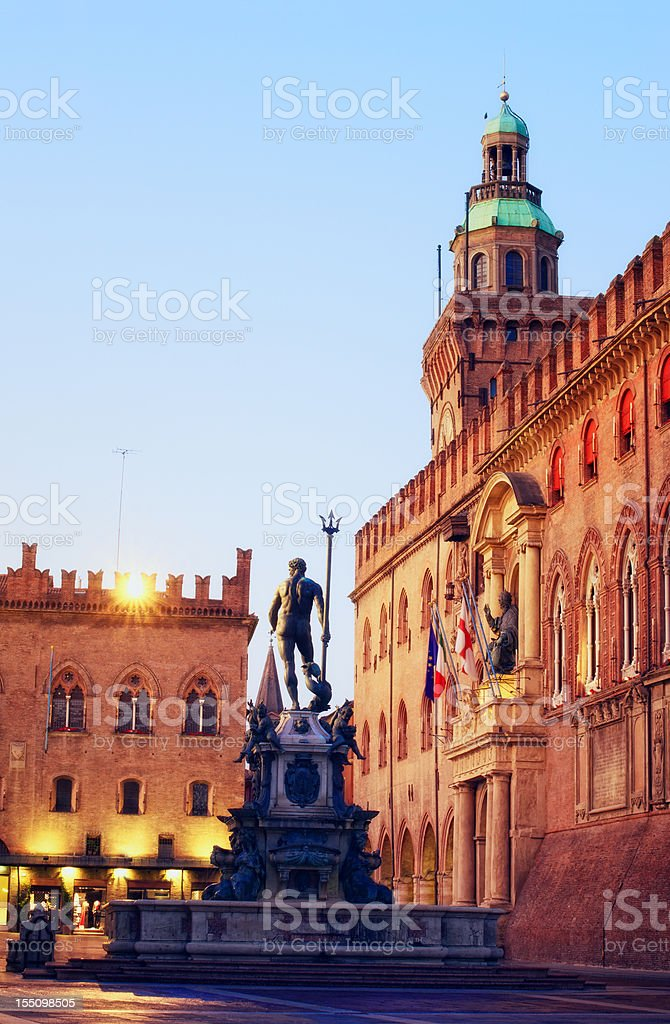 Neptune fountain and Piazza Maggiore in Bologna Italia at dawn stock photo