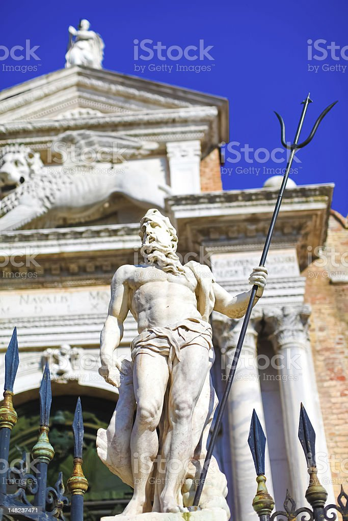 Neptune with trident close to Venetian arsenal royalty-free stock photo