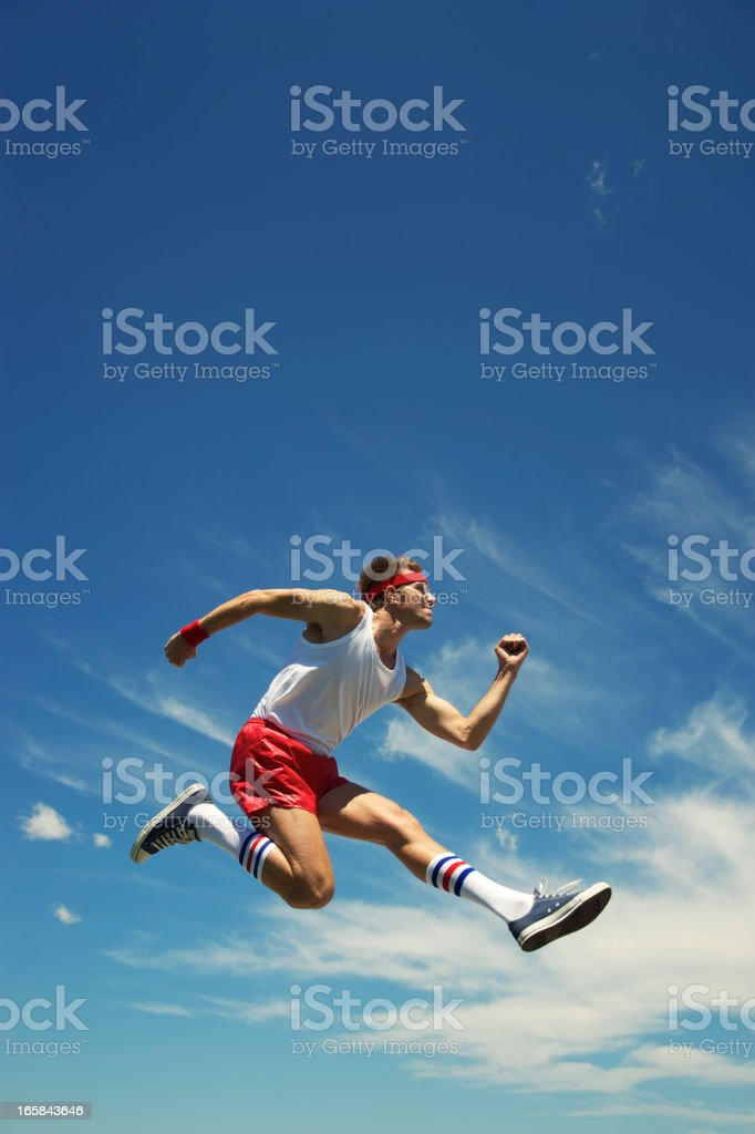 Nerd Athlete Hurdle Jumps Blue Sky royalty-free stock photo