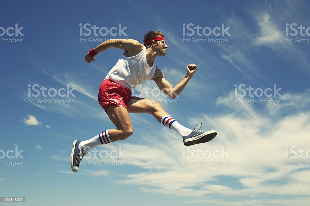 Nerd Athlete Hurdle Jumps Blue Sky stock photo