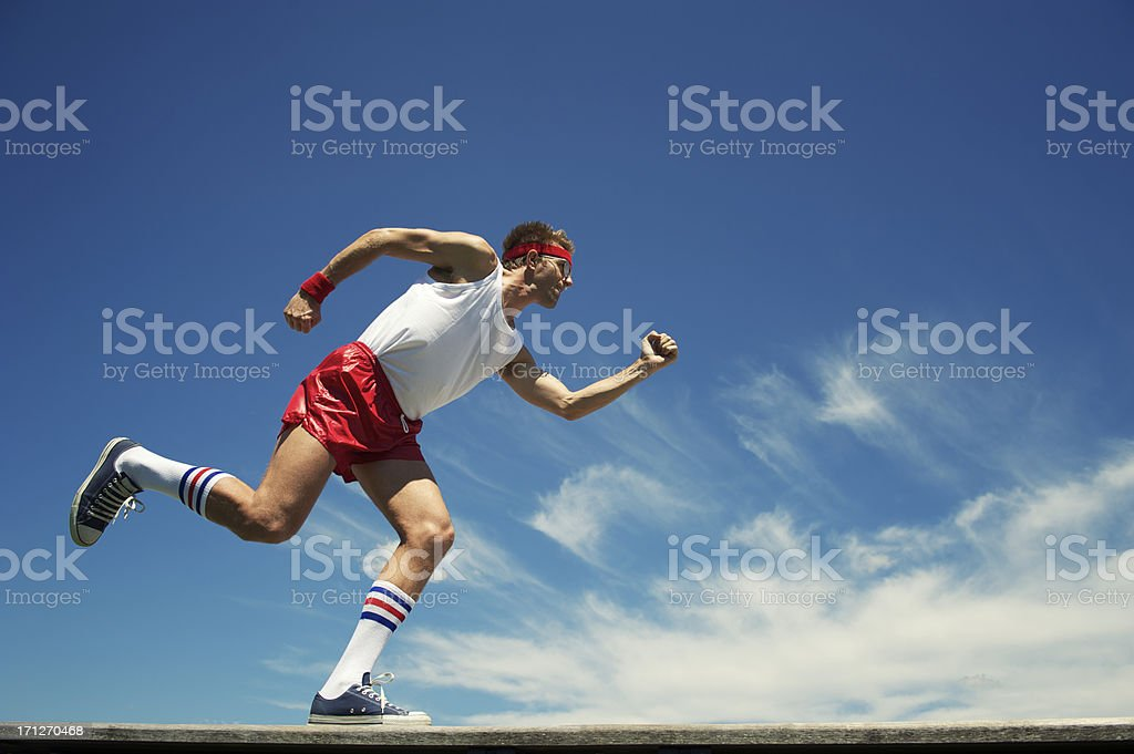 Nerd Athlete Runs Across Blue Sky royalty-free stock photo