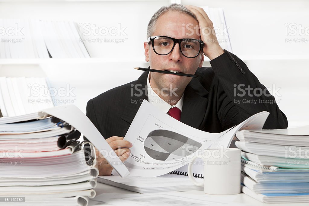 Nerd businessman stressed out at work royalty-free stock photo