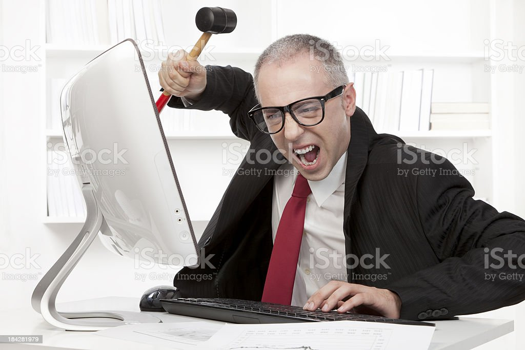 Nerd businessman stressing out at work royalty-free stock photo