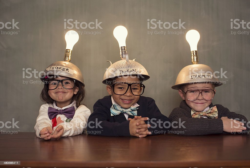 Nerd Children Wearing Lighted Mind Reading Helmets stock photo