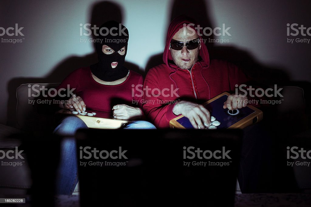 Nerd couple playing video games royalty-free stock photo