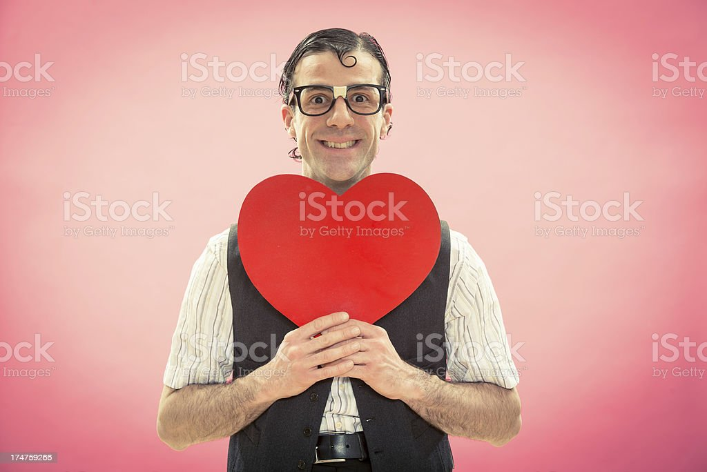 Nerd courting his girlfriend in valentine day royalty-free stock photo