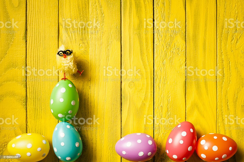 Nerd Easter Chicken - Balancing Egg Humor Wood Season Background stock photo