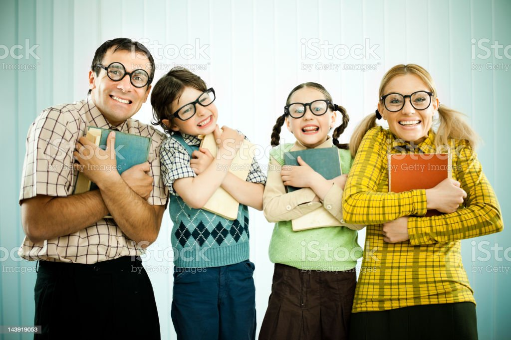 Nerd family holding their books and looking at the camera. royalty-free stock photo