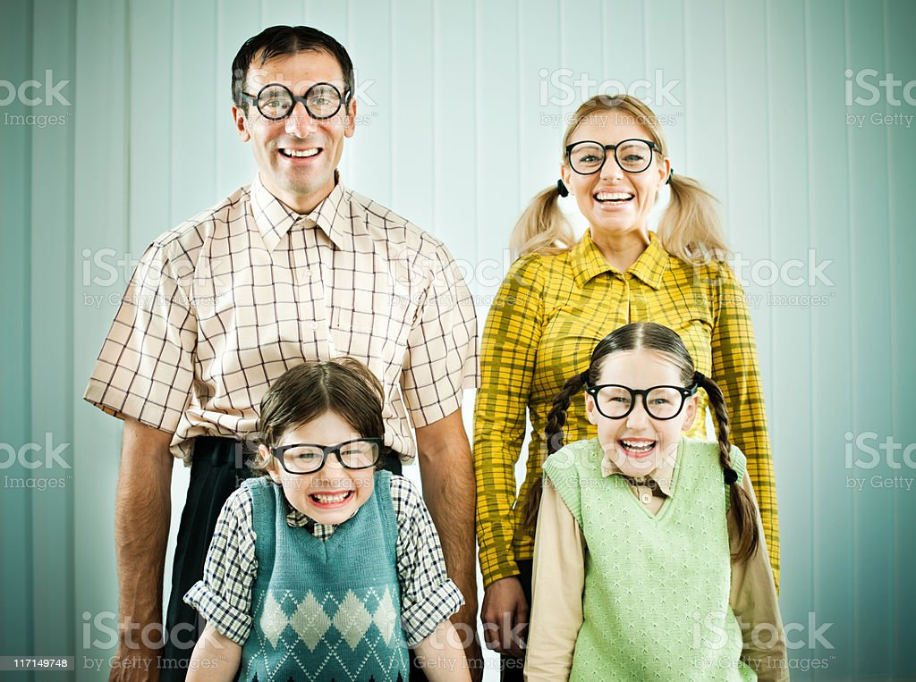 Nerd family standing shyly and looking at the camera. stock photo