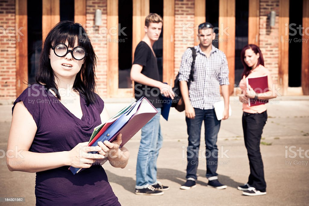 nerd getting mobbed by her fellow students royalty-free stock photo
