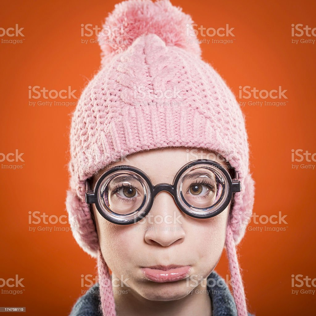Nerd girl wearing wool hat royalty-free stock photo