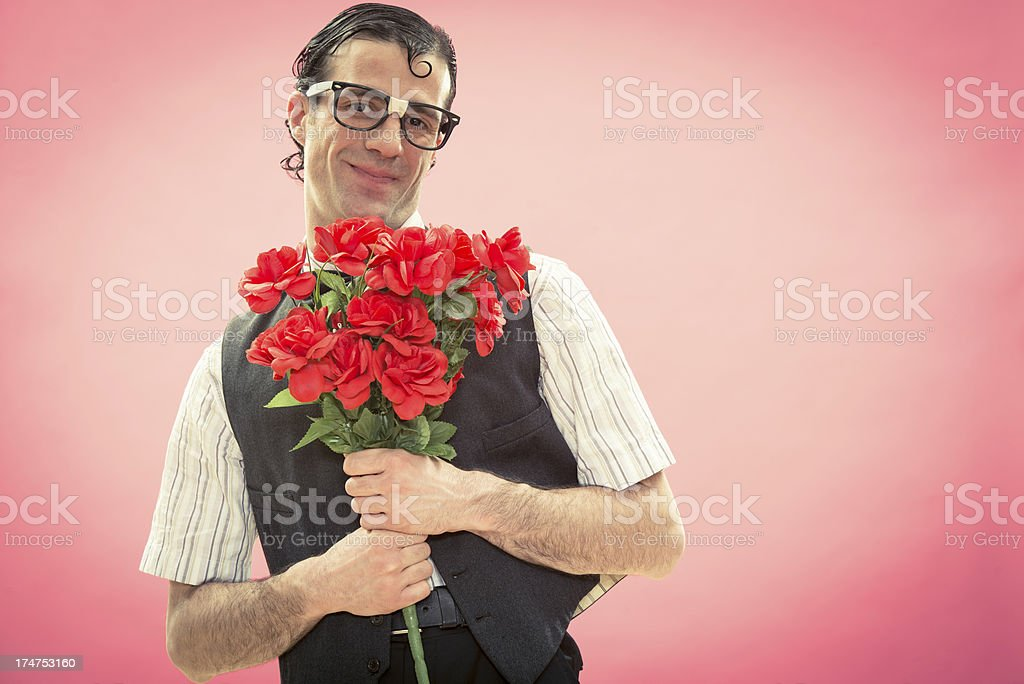 Nerd gives flowers to his girlfriend in valentine day stock photo