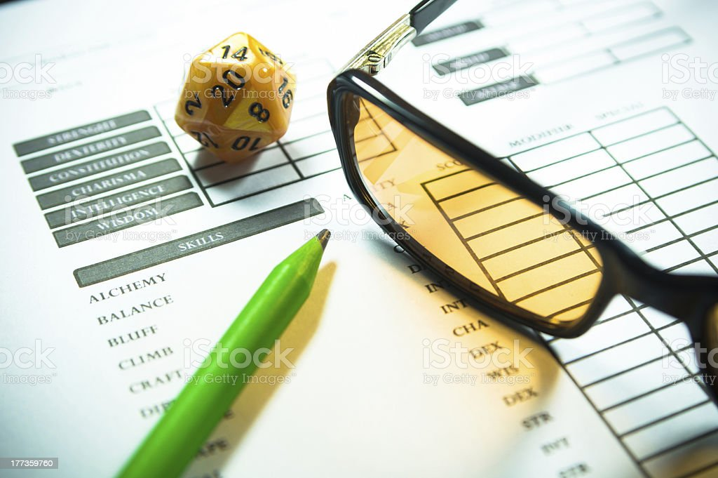 Nerd Glass Pencil and Dice RPG Character Sheet stock photo