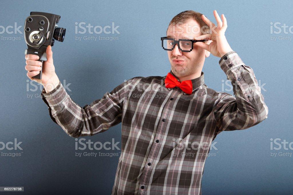 Nerd guy filming himself stock photo