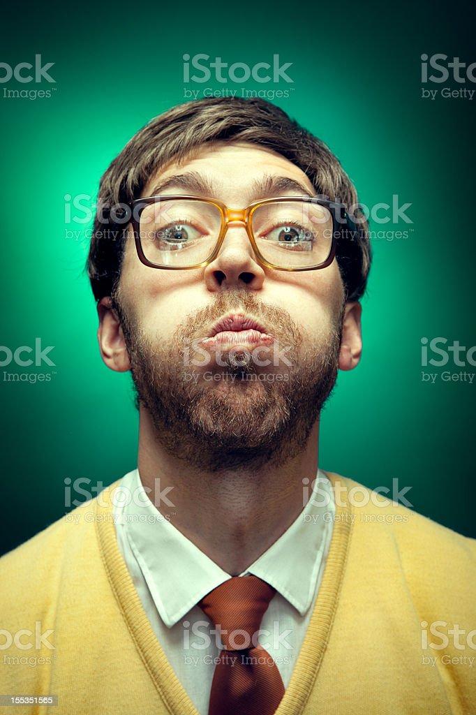 Nerd Guy Holding His Breath stock photo