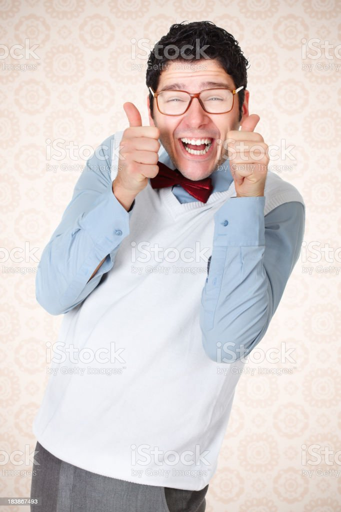 Nerd guy with beautiful smile holding thumbs up royalty-free stock photo